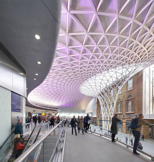 The radial beams together with the diagonal struts form a flat arched shell structure for King's Cross station in London.