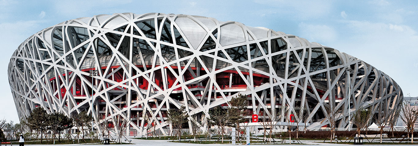 The Bird's Nest Olympiastadium in Beijing, Singapur is a stadium out of a woven steel structure and translucent membrane.