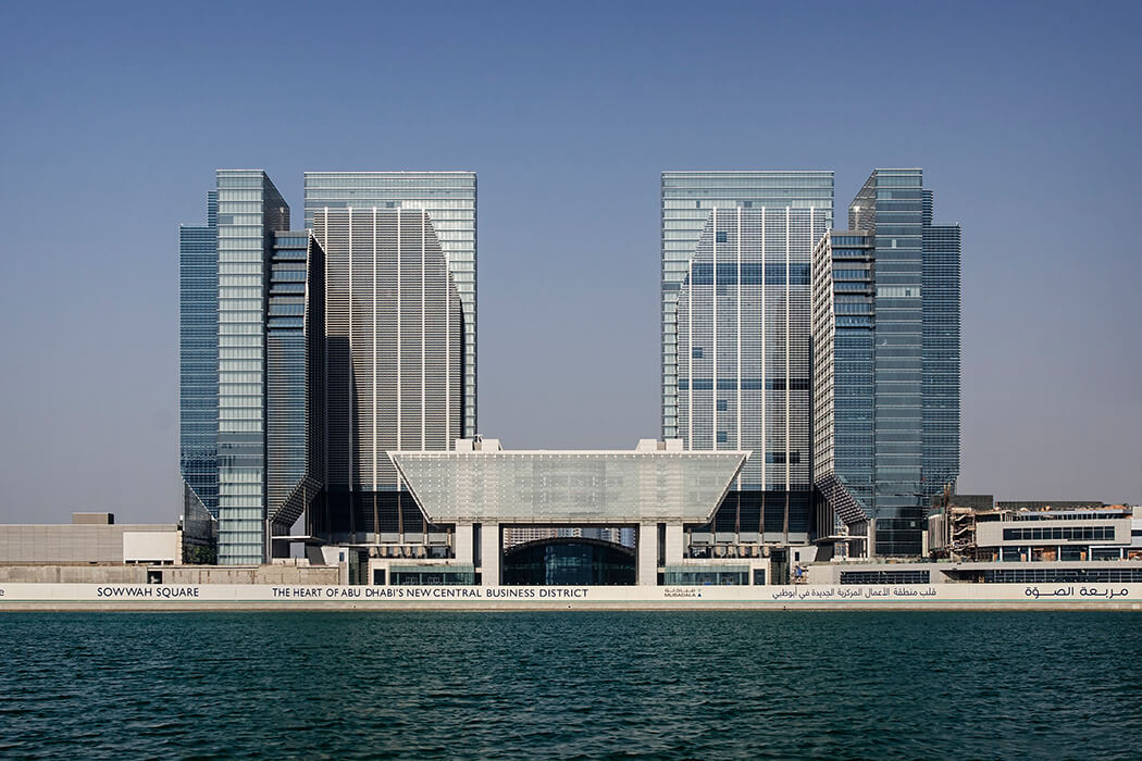 Four office Towers frame the stock exchange building in the middle with the 12,000sqm glass façade.